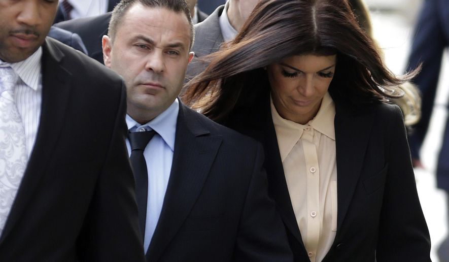 "FILE - In this Oct. 2, 2014, file photo, ""The Real Housewives of New Jersey"" stars Giuseppe ""Joe"" Giudice, center, and his wife, Teresa Giudice, right, of Montville Township, N.J., walk toward the Martin Luther King Jr. Courthouse before a court appearance, in Newark, N.J. A lawyer for Teresa Giudice tells The Record she will be released Wednesday, Dec. 23, 2015, from the Danbury Federal Correctional Institution in Connecticut. She will then head home to her husband and four daughters in Montville, where she will be on home confinement until Feb. 5. (AP Photo/Julio Cortez, File)"
