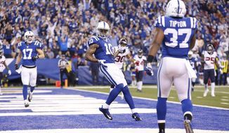 Indianapolis Colts' Donte Moncrief (10) celebrates after a 11-yard touchdown reception during the first half of an NFL football game against the Houston Texans, Sunday, Dec. 20, 2015, in Indianapolis. (AP Photo/AJ Mast)