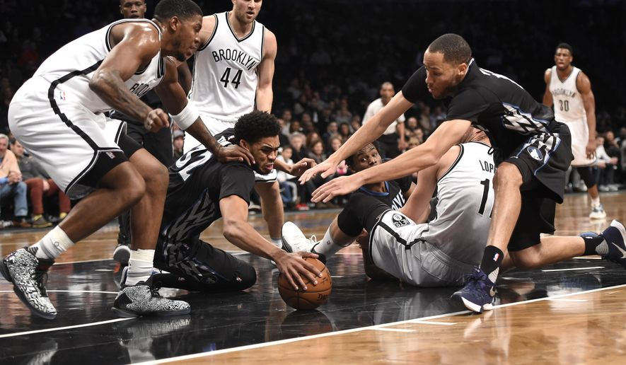 Brooklyn Nets forward Joe Johnson (7), Minnesota Timberwolves center Karl-Anthony Towns (32), Nets center Brook Lopez (11) and Timberwolves forward Tayshaun Prince (12) scramble for a loose ball during the first half of an NBA basketball game on Sunday, Dec. 20, 2015, in New York. (AP Photo/Kathy Kmonicek)
