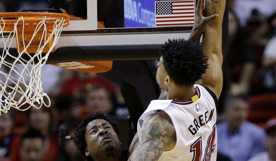 Miami Heat's Gerald Green (14) is fouled by Portland Trail Blazers' Ed Davis (17) in the first half of an NBA basketball game, Sunday, Dec. 20, 2015, in Miami. (AP Photo/Lynne Sladky)