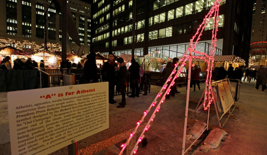 "An 8-and-a-half foot tall letter ""A,"" which stands for Atheist or Agnostic, erected by the Wisconsin-based Freedom From Religion Foundation, is on display at the annual Christmas market in Chicago's Daley Plaza on Dec. 12, 2013. Members of the group say it's meant to send a message that they believe that religious displays on public property are a violation of the separation of church and state. (Associated Press) **FILE**"