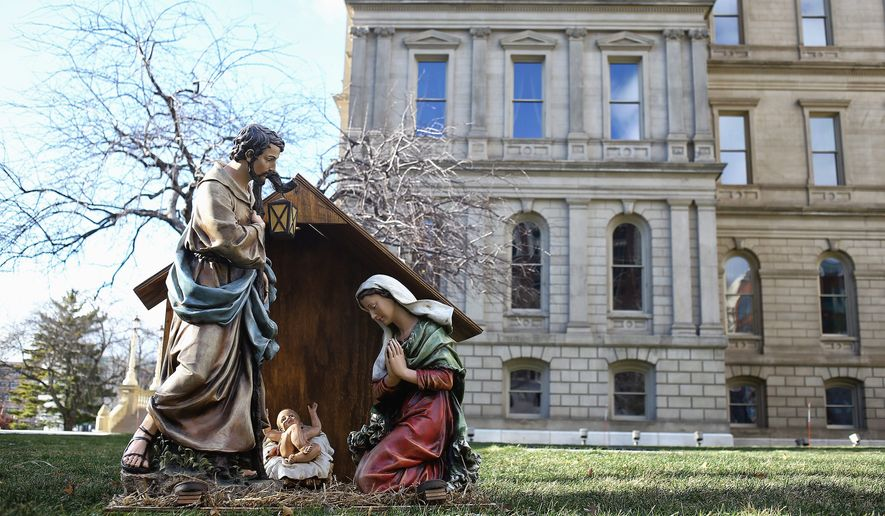 """A Nativity display from a Christian sits on the west side of the Capitol lawn in Lansing, Michigan. The lawn also has a display of the Satanic Temple from Detroit's """"Snaketivity"""" scene. (Associated Press)"""