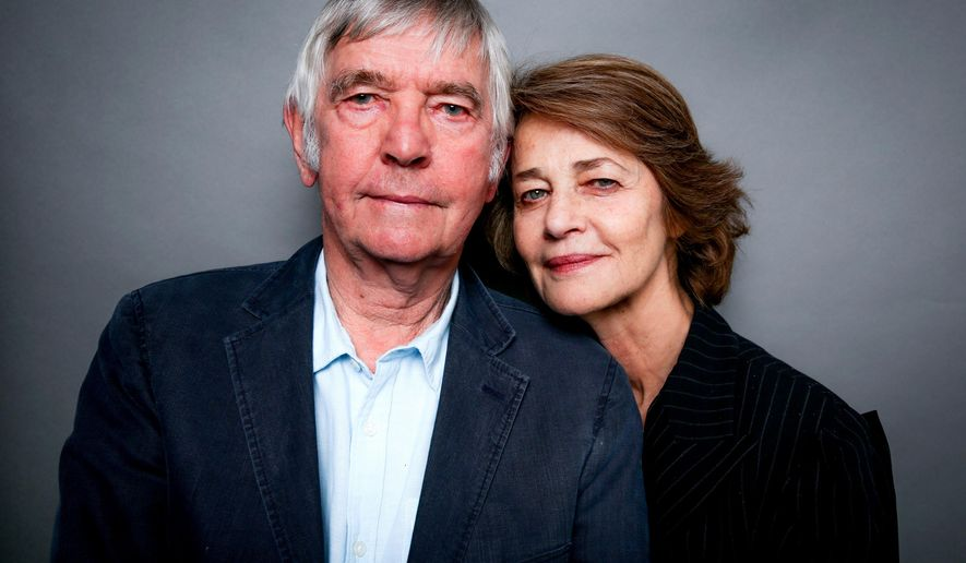 """In this Wednesday, Nov. 11, 2015 photo, Tom Courtenay, left, and Charlotte Rampling pose for a portrait in West Hollywood, Calif. Courtenay and Rampling might be cinematic contemporaries in our popular imagination, but they were near strangers when they began work on the marital drama """"45 Years."""" Still, you wouldn't know it from the film, or their cheeky, sarcastic in-person banter. (Photo by Rich Fury/Invision/AP)"""