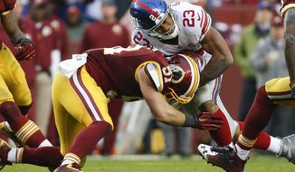 Washington Redskins inside linebacker Will Compton (51) stops New York Giants running back Rashad Jennings (23) during the second half of an NFL football game in Landover, Md., Sunday, Nov. 29, 2015. (AP Photo/Alex Brandon)