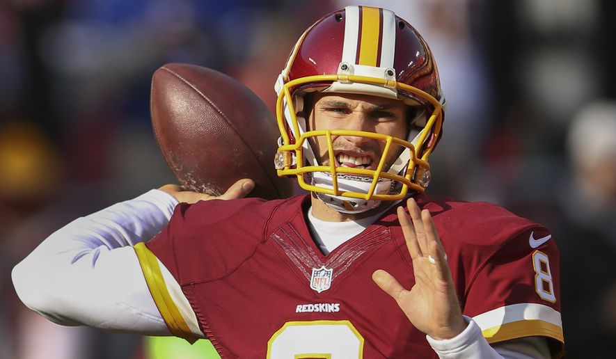 Kirk Cousins warms up before an NFL football game against the Buffalo Bills in Landover, Md., Sunday, Dec. 20, 2015. (AP Photo/Andrew Harnik)