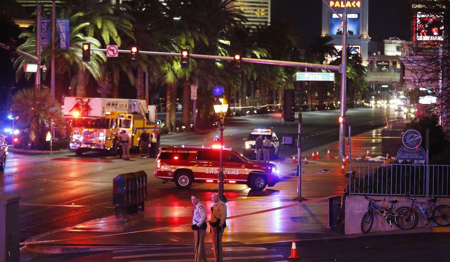 Police and emergency crews respond to the scene of a car accident along Las Vegas Boulevard, Sunday, Dec. 20, 2015, in Las Vegas. (AP Photo/John Locher)