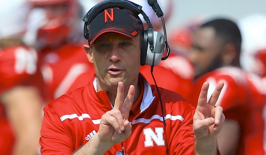 FILE - In this April 11, 2015, file photo, Nebraska head coach Mike Riley signals during the annual NCAA college football Red-White spring game in Lincoln, Neb. Riley remembers a time in the not-so-distant past when there was not much emphasis on how each individual conference fared during bowl season. (AP Photo/Nati Harnik, File)