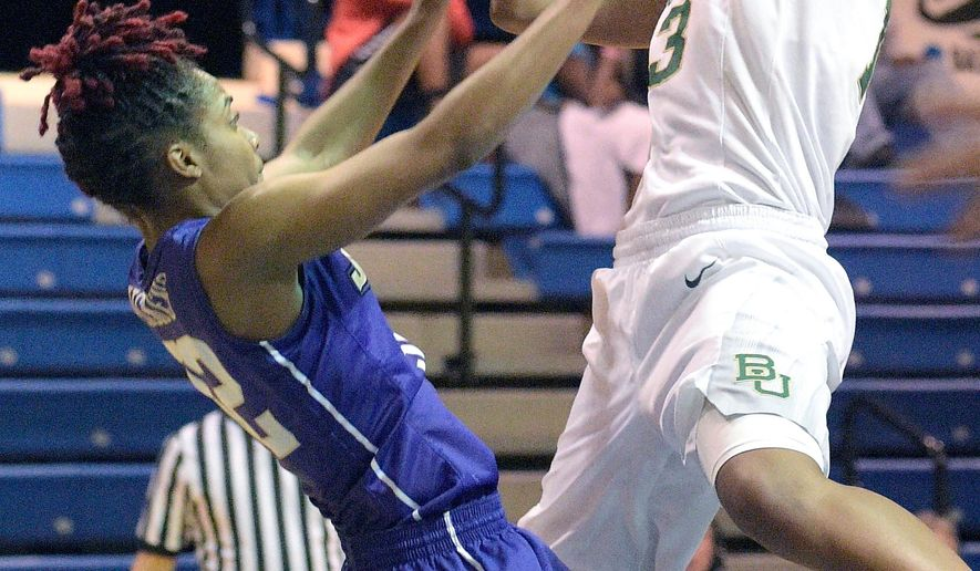 Baylor forward Nina Davis, right, goes up for a shot in front of James Madison guard Angela Mickens during the first half of an NCAA college basketball game in Winter Park, Fla., Monday, Dec. 21, 2015. (AP Photo/Phelan M. Ebenhack)