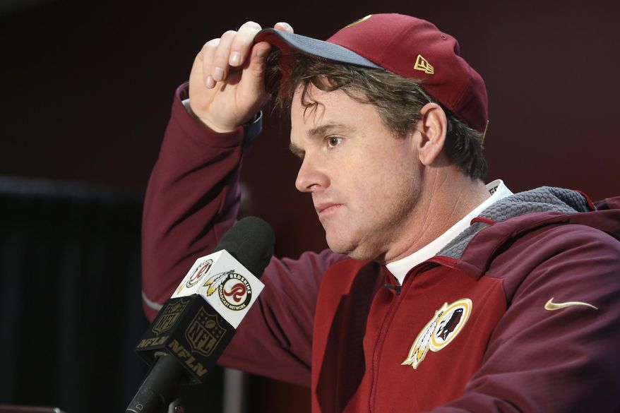 In this Dec. 20, 2015, photo, Washington Redskins head coach Jay Gruden pulls on his cap during a post-game news conference after the NFL football game against the Buffalo Bills in Landover, Md., Sunday, Dec. 20, 2015. The Washington Redskins defeated the Buffalo Bills 35-25. Forget about complicated playoff permutations. It's suddenly all become so simple for the Washington Redskins: Win their game against the Philadelphia Eagles next weekend, and coach Gruden's club will clinch the NFC East title.(AP Photo/Andrew Harnik)