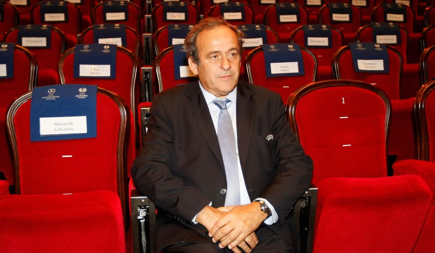 FILE - In this Aug. 28, 2015 file photo UEFA President Michel Platini, attends the soccer Europa League draw ceremony at the Grimaldi Forum, in Monaco. Sepp Blatter and Michel Platini have been banned for 8 years, the FIFA ethics committee said Monday,  Dec. 21, 2015.  (AP Photo/Claude Paris, file)