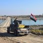 Iraqis rebuilt a bridge over the Euphrates River after the Islamic State destroyed all crossings leading to central Ramadi. The military reported progress Tuesday in its move to retake the provincial capital. (Associated Press)