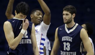 George Washington forward Yuta Watanabe, left, and guard/forward Patricio Garino react after forward Kevin Larsen missed a basket during the second half of an NCAA college basketball game against DePaul on Tuesday, Dec. 22, 2015, in Rosemont, Ill. DePaul won 82-61. (AP Photo/Nam Y. Huh)