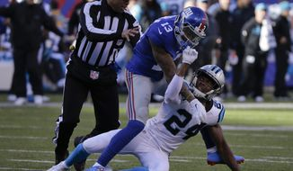 A referee steps in to separate New York Giants wide receiver Odell Beckham (13) and Carolina Panthers' Josh Norman (24) as they scuffle during the first half of an NFL football game Sunday, Dec. 20, 2015, in East Rutherford, N.J. (AP Photo/Julie Jacobson)
