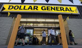 Customers exit a Dollar General store in San Antonio on Sept. 25, 2013. (Associated Press) **FILE**