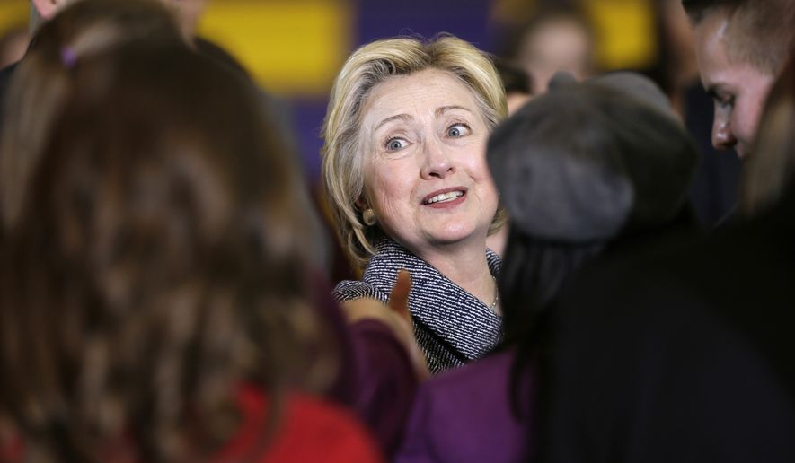 Democratic presidential candidate Hillary Clinton greets supporters during a town hall meeting at Keota High School, Tuesday, Dec. 22, 2015, in Keota, Iowa. (AP Photo/Charlie Neibergall)