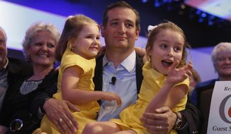 Republican presidential candidate and Sen. Ted Cruz holds his daughters Catherine (left) and Caroline at a rally in Des Moines, Iowa, on Aug. 21, 2015. (Associated Press)