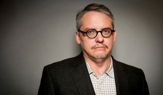 "In this Monday, Nov. 30, 2015, photo, director Adam McKay poses for a portrait in Los Angeles. McKay's new film, ""The Big Short"" opens in U.S. theaters on Dec. 23, 2015.  (Photo by Rich Fury/Invision/AP)"