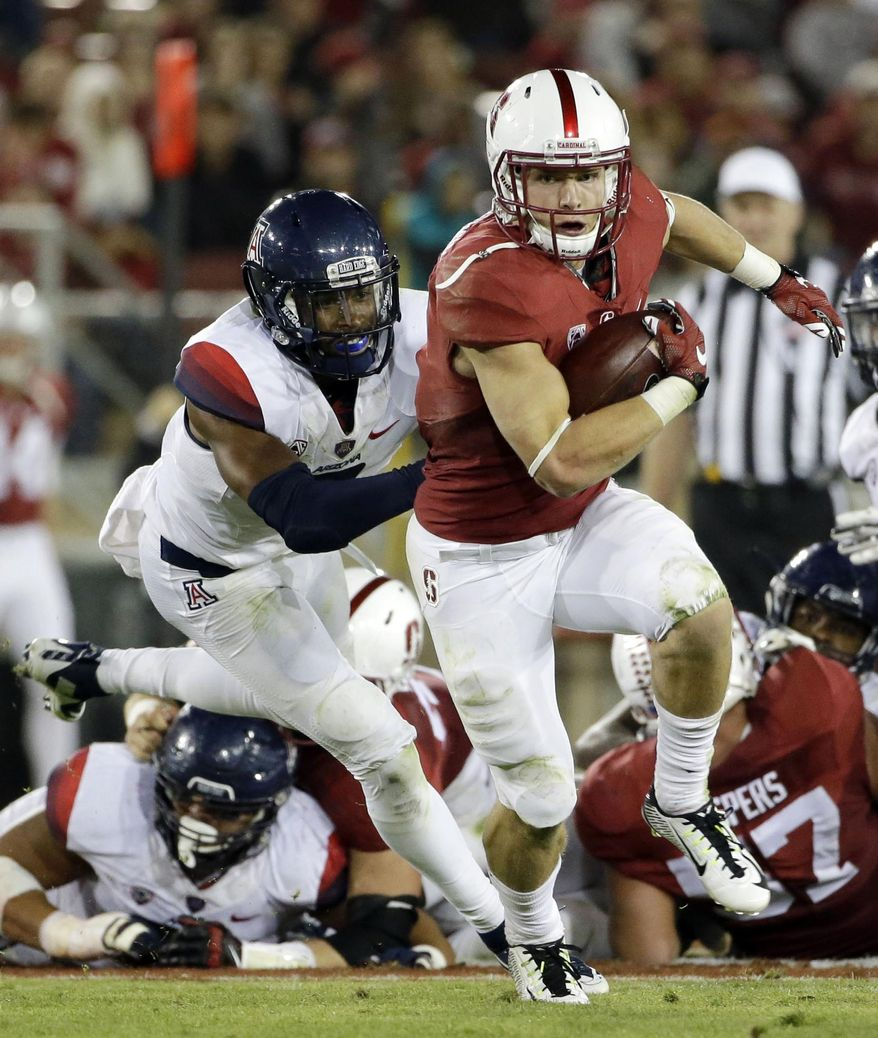 FILE - In this Oct. 3, 2015, file photo, Stanford's Christian McCaffrey rushes against Arizona during an NCAA college football game in Stanford, Calif. McCaffrey was selected as The Associated Press college football player of the year on Tuesday, Dec. 22, 2015, becoming the first non-Heisman Trophy winner to earn the honor in six years. (AP Photo/Marcio Jose Sanchez, File)