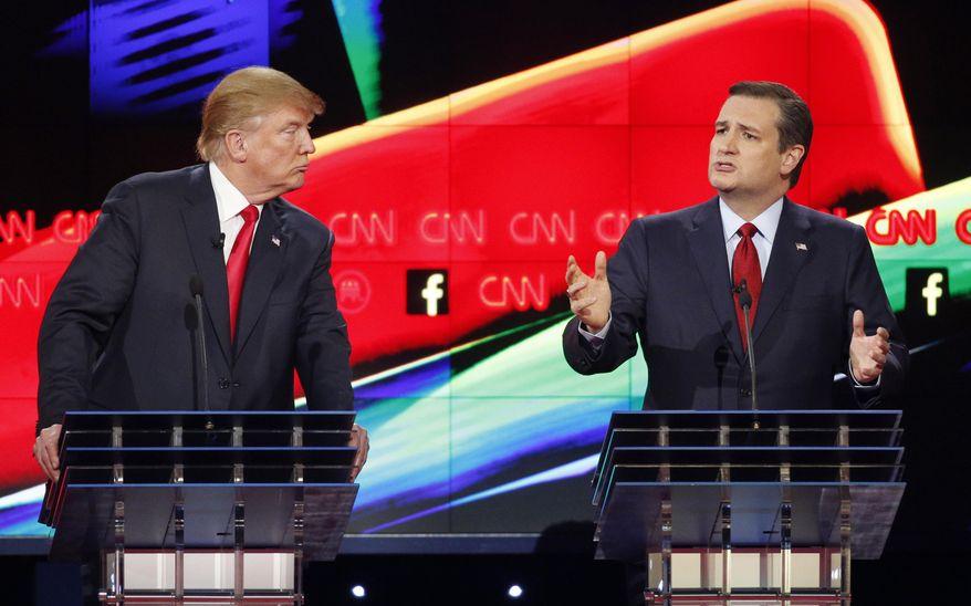 In this Dec. 15, 2015, file photo, Donald Trump, left, watches as Ted Cruz speaks during the CNN Republican presidential debate at the Venetian Hotel & Casino in Las Vegas. (AP Photo/John Locher) ** FILE **