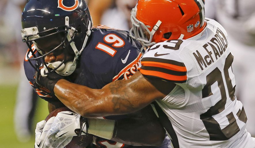 FILE- In this Aug. 29, 2013, file photo, Chicago Bears wide receiver Joe Anderson (19) is tackled by Cleveland Browns cornerback Leon McFadden (29) during the first half of a preseason NFL football game in Chicago. Anderson was signed to the New York Jets' practice squad Tuesday, Dec. 22, 2015, about six weeks after he stood outside the Houston Texans' stadium for a few days with a sign asking for an NFL job. (AP Photo/Charles Rex Arbogast, File)