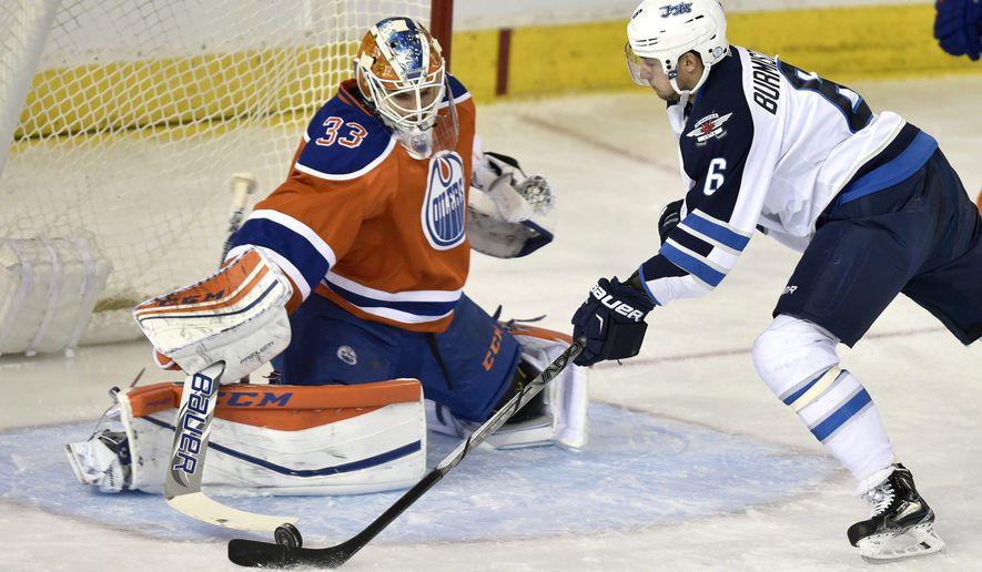 Winnipeg Jets' Alexander Burmistrov (6) is stopped by Edmonton Oilers goalie Cam Talbot during the second period of an NHL hockey game in Edmonton, Alberta, Monday, Dec. 21, 2015.  (John Ulan/The Canadian Press via AP) MANDATORY CREDIT