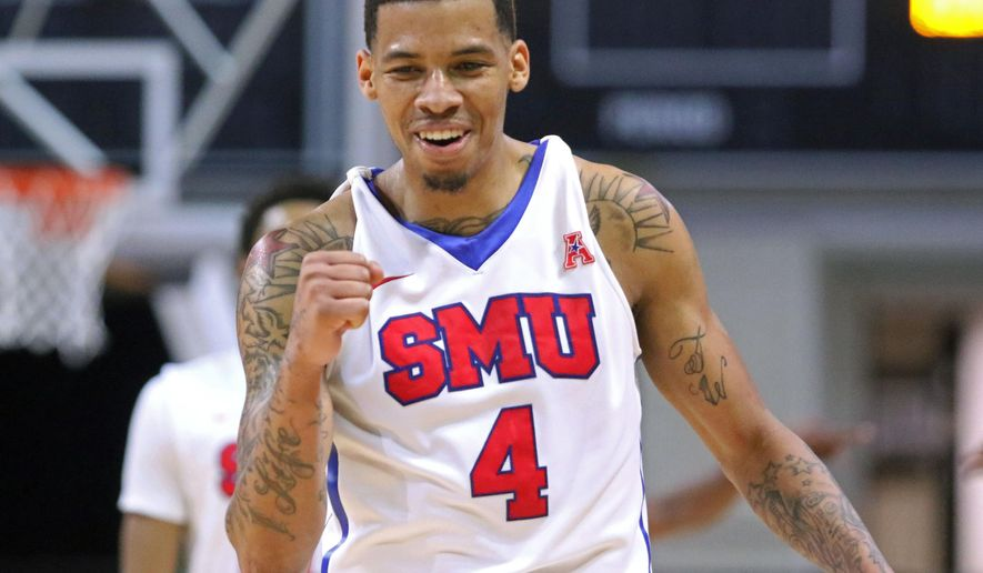 SMU's Keith Frazier reacts to a play in the second half of an NCAA college basketball game against Kent State Wednesday, Dec. 22, 2015, in Las Vegas. SMU won 90-74. (AP Photo/Ronda Churchill)