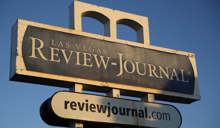 FILE - In this Thursday, Dec. 17, 2015, file photo, an exterior sign for the Las Vegas Review-Journal is seen in Las Vegas. The family of billionaire casino mogul and GOP kingmaker Sheldon Adelson confirmed in a statement to the Las Vegas Review-Journal that they are the new owners of Nevada's largest newspaper. (AP Photo/John Locher, File)