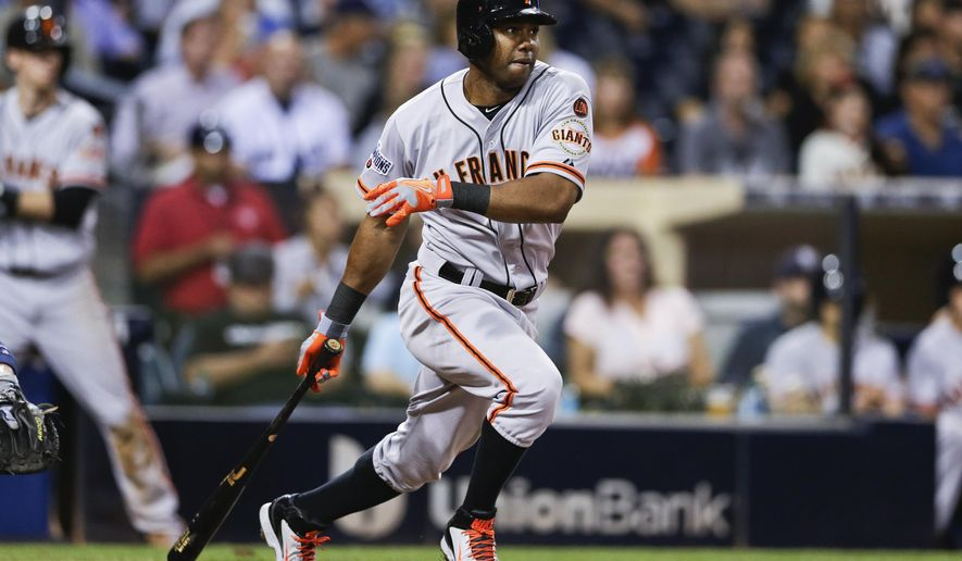 FILE - In this Sept. 24, 2015, file photo, San Francisco Giants' Alejandro De Aza watches his RBI single against the San Diego Padres during the third inning of a baseball game in San Diego. A person familiar with the negotiations says outfielder Alejandro De Aza and the New York Mets have agreed to a contract, pending a physical. The person spoke on condition of anonymity Tuesday, Dec. 22, 2015, because the agreement had not been announced. (AP Photo/Gregory Bull, File)