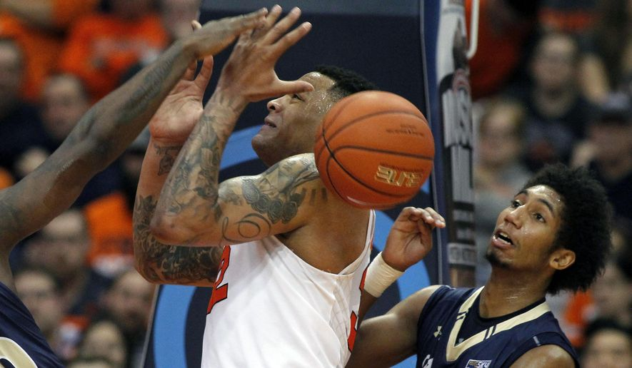Syracuse's Dajuan Coleman, left, tries to grab a rebound under pressure from Montana State's Tyler Hall, right, in the first half of an NCAA college basketball game in Syracuse, N.Y., Tuesday, Dec. 22, 2015. (AP Photo/Nick Lisi)