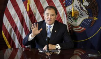 FILE - In this Feb. 5, 2015, file photo, Utah Gov. Gary Herbert speaks to reporters during a news conference at the Utah State Capitol in Salt Lake City. A federal judge has reversed an earlier decision and ruled Utah can cut off federal funds to the state Planned Parenthood organization. The ruling from U.S. District Judge Clark Waddoups on Tuesday, Dec. 22, temporarily upholds  Herbert's order to end contracts for sex education and sexually transmitted disease testing programs.  (AP Photo/Rick Bowmer, File)