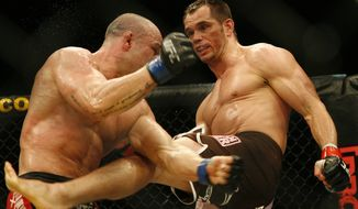 Silva Wanderlei from Brazil, left, fights against U.S. Rich Franklin from Cincinnati, Ohio during their Ultimate Fighting Championship comback bout in Cologne, Germany, on Saturday, June 13, 2009. The Ultimate Fighting Championship UFC is the world leading professional mixed martial arts MMA organization. Franklin won the bout. (Associated Press)  **FILE**