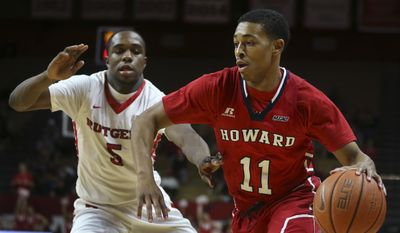 Howard guard James Daniel (11) dribbles the ball past Rutgers guard Mike Williams during the first half of an NCAA college basketball game Sunday, Nov. 15, 2015, in Piscataway, N.J. (AP Photo/Mel Evans)