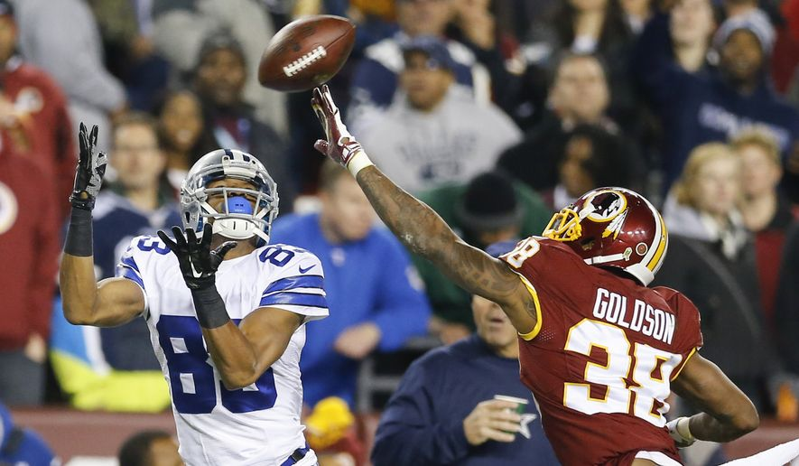 Dallas Cowboys wide receiver Terrance Williams (83) pulls in a pass under pressure from Washington Redskins free safety Dashon Goldson (38) during the first half of an NFL football game in Landover, Md., Monday, Dec. 7, 2015. (AP Photo/Patrick Semansky)