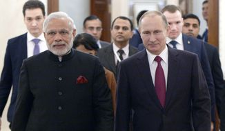 Russian President Vladimir Putin, right, and Indian Prime Minister Narendra Modi walk together during their meeting in the Kremlin in Moscow, Belarus, Wednesday, Dec. 23, 2015. (Alexei Nikolsky, Sputnik, Kremlin Pool Photo via AP)