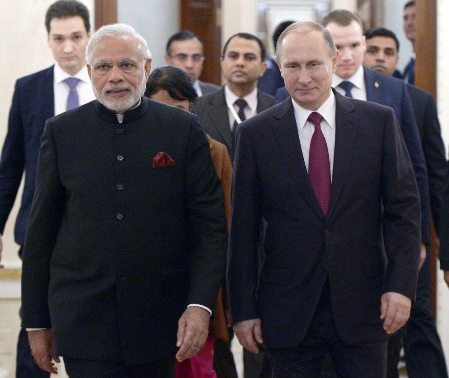 Russian President Vladimir Putin, right, and Indian Prime Minister Narendra Modi walk together during their meeting in the Kremlin in Moscow, Belarus, Wednesday, Dec. 23, 2015. (Alexei Nikolsky, Sputnik, Kremlin Pool Photo via AP)