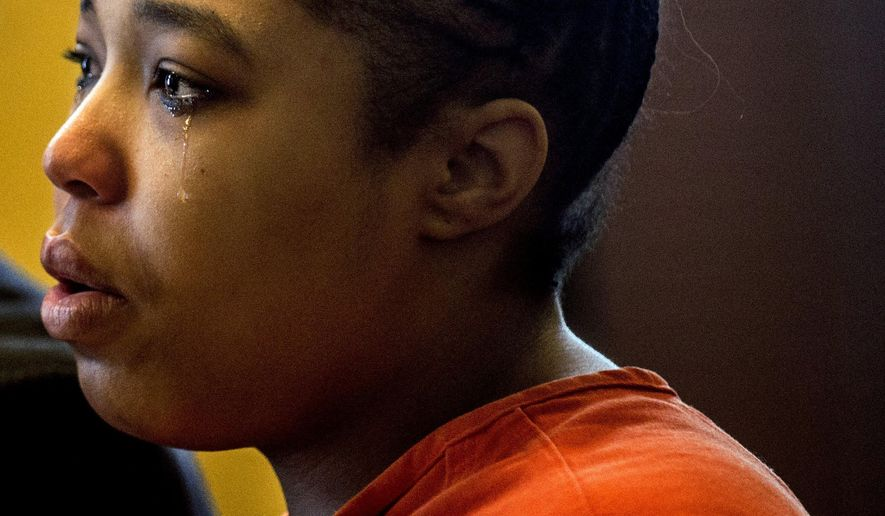 Tears fall down on the face of Crystal Shelton-Randolph, 25, Wednesday, Dec. 23, 2015 at Genesee County Circuit Court in Flint, Mich., Wednesday, Dec. 23, 2015. Shelton-Randolph, whose twins died about two months apart, returned to court for her sentence after pleading no contest to second-degree murder. (Jake May/The Flint Journal-MLive.com via AP) MANDATORY CREDIT
