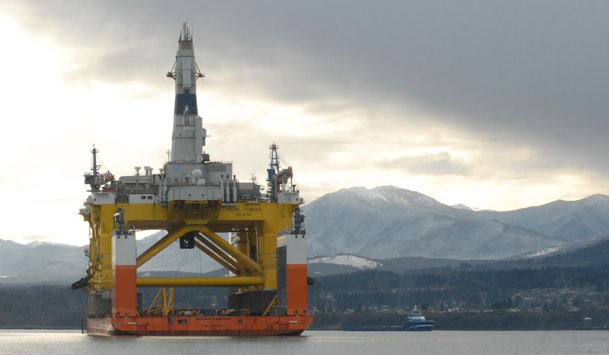 The floating oil drilling platform Polar Pioneer sits atop the semi-submersible heavy-lift transport ship Dockwise Vanguard on Tuesday, Dec. 22, 2015 in Port Angeles Harbor near Port Angeles, Wash. The Arctic drilling rig that has made its home in the Port Angeles harbor in Washington state is expected to depart for Europe on Wednesday, Dec. 23, 2015. (Keith Thorpe/The Peninsula Daily News via AP)