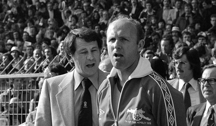 FILE - This May 6, 1978 file photo shows Don Howe, right, in London. Don Howe, a former England defender who became a key member of the England coaching staff, has died. He was 80. Howe's death was announced Wednesday Dec. 23, 2015 by the English Football Association as well as West Bromwich Albion and Arsenal, two teams he played for and managed. (PA via AP, File)