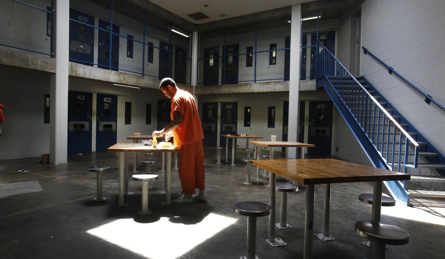 In this May 30, 2013 file photo, an inmate uses the recreation room of one of the housing units at Sacramento County's Rio Cosumnes Correctional Center in Elk Grove, Calif. (AP Photo/Rich Pedroncelli, File)