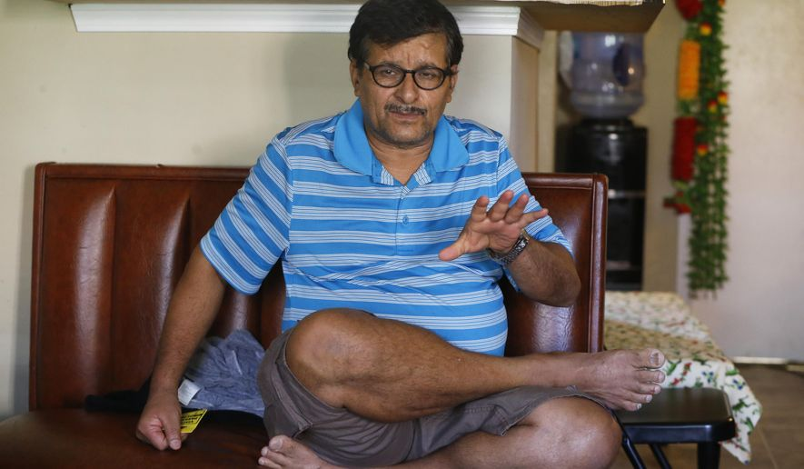 In this Oct. 23, 2015 photo, Ram Siwakoti, a 57-year-old refugee from Bhutan, talks about his family's experience renting an apartment until July 2014 from Davin Gartley during an interview at his new residence in Pittsburgh. Siwakoti paid $600 a month so his wife, two sons and elderly parents could share one of Gartley's run-down apartments with no running water and intermittent sewage service. The Pennsylvania attorney general filed a lawsuit against Gartley in May 2015. (AP Photo/Keith Srakocic)
