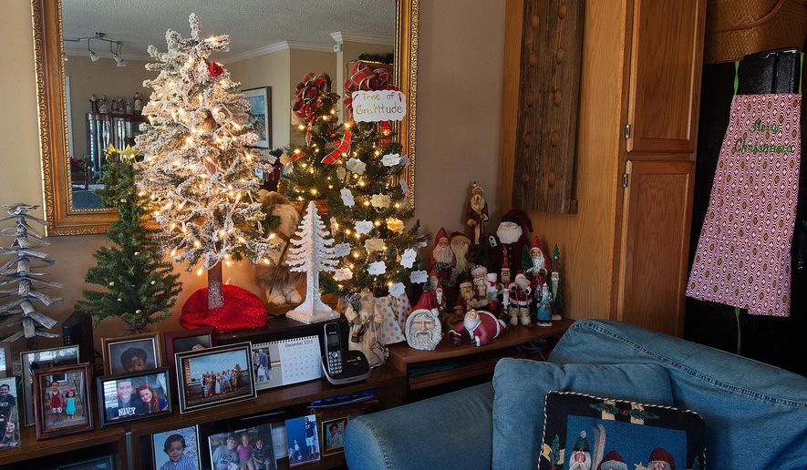 ADVANCED FOR RELEASE THURSDAY, DECEMBER 24, 2015 In an area of the family room named 'William's Woods' sits a 'tree of gratitude' (right) on Wednesday, Dec. 16, 2015 where High Rock Lake homeowners Patsie and Bill Baker encourage people to write on a card ornament something they are thankful for and then hang it on the tree. (Donnie Roberts/The Lexington Dispatch via AP)