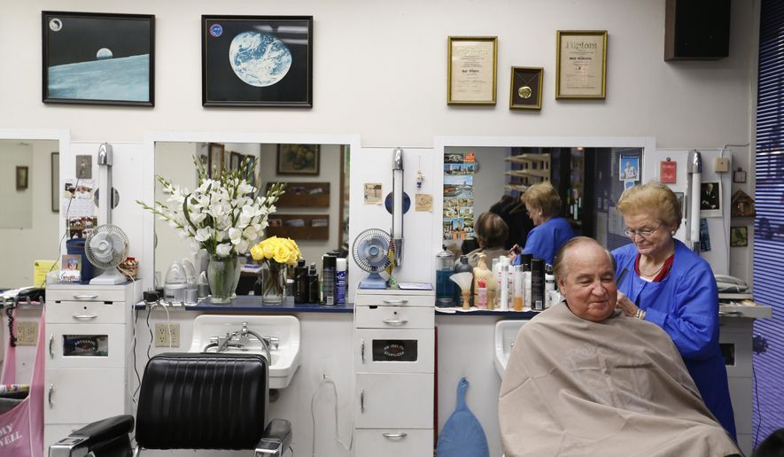 In this Tuesday, Dec. 8, 2015 photo, Inge Bentjen works on long-time customer Jim Erwin at her barbershop in Dallas. For the last 52 years, Bentjen has cut hair for dozens of prominent Dallasites. On Friday, Dec. 25, she plans to close the doors of Inge's Barber Shop in downtown Dallas for good. (Jae S. Lee/The Dallas Morning News via AP) MANDATORY CREDIT; MAGS OUT; TV OUT; INTERNET USE BY AP MEMBERS ONLY; NO SALES