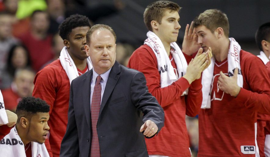 Wisconsin interim head coach Greg Gard talks to his team during the first half of an NCAA college basketball game against Green Bay Wednesday, Dec. 23, 2015, in Madison, Wis. (AP Photo/Andy Manis)