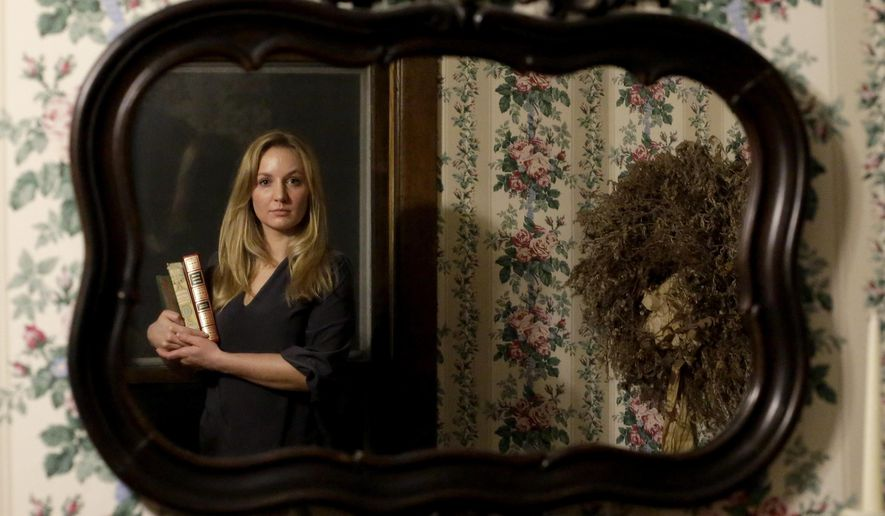 Jacqueline Suriano poses at her home on Wednesday, Dec. 23, 2015, in Riverside, Ill. The 26-year-old psychology major has resorted to crowdfunding her college education because of the prolonged budget stalemate in the Illinois capital. (AP Photo/Nam Y. Huh)