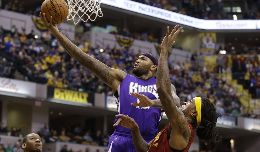 Sacramento Kings forward DeMarcus Cousins (15) shoots in front of Indiana Pacers center Jordan Hill, right, during the first half of an NBA basketball game in Indianapolis, Wednesday, Dec. 23, 2015. (AP Photo/Michael Conroy)