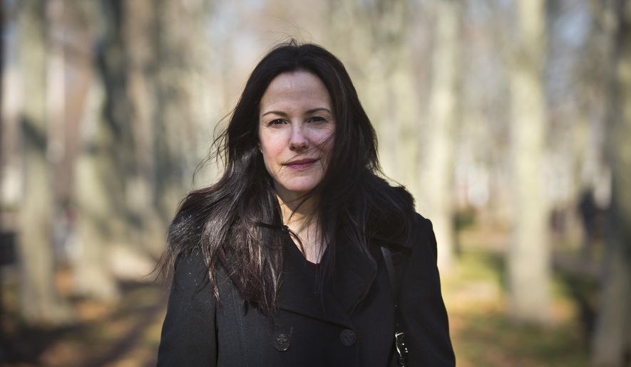 "In this Dec. 7, 2015 photo, actress and author Mary-Louise Parker poses for portrait in a park in the Brooklyn borough of New York. Parker's ""Dear Mr. You,"" a collection of lyrical and often emotional essays about men addressed to everyone from former (and unnamed) lovers to family members, has been highly praised by critics and made the actress a respected name in the literary world. (AP Photo/Bebeto Matthews)"