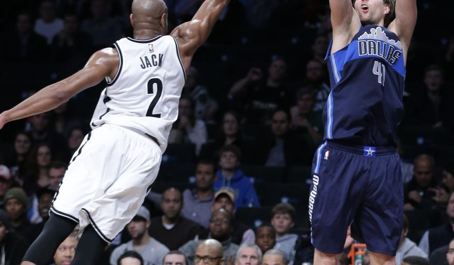 Dallas Mavericks' Dirk Nowitzki (41) shoots a 3-point basket over Brooklyn Nets' Jarrett Jack (2) to end the first half of an NBA basketball game Wednesday, Dec. 23, 2015, in New York. (AP Photo/Frank Franklin II)