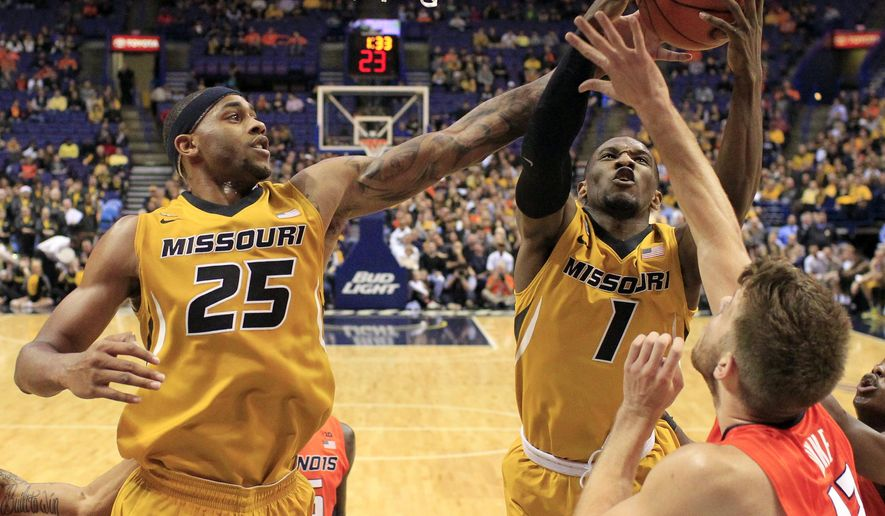 Missouri's Russell Woods (25) and Terrence Phillips (1) reach for a rebound in front of Illinois' Michael Finke, right, during the first half of an NCAA college basketball game Wednesday, Dec. 23, 2015, in St. Louis. (AP Photo/Jeff Roberson)