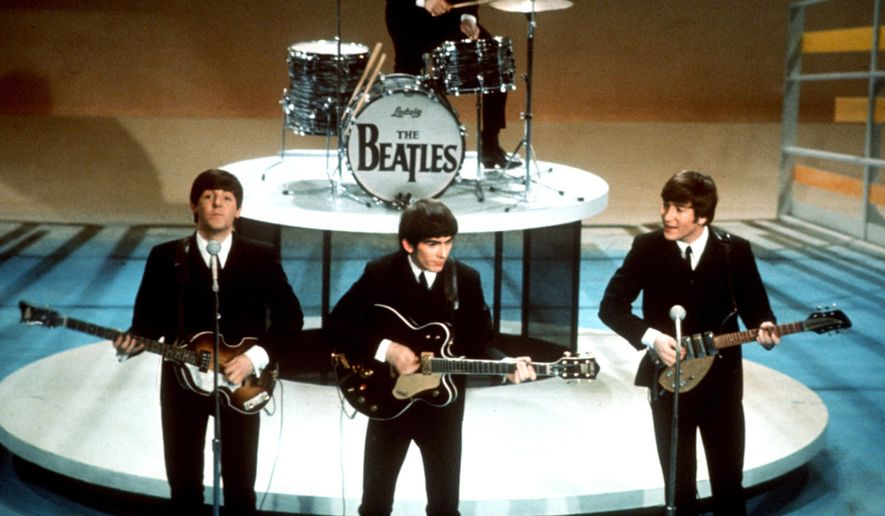 "FILE - In this Feb. 9, 1964 file photo, The Beatles perform on the CBS ""Ed Sullivan Show"" in New York. They love us, yeah! yeah! yeah! At 12:01 a.m. local time on Dec. 24, 2015, around the world, the Beatles' music will be available for streaming from a wide range of outlets, a representative announced Wednesday, Dec. 23. (AP Photo, File)"