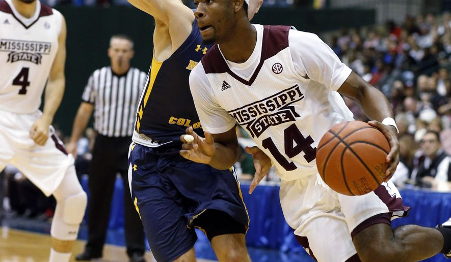 Mississippi State guard Malik Newman (14) dribbles past a Northern Colorado player during the first half of an NCAA college basketball game in Jackson, Miss., Wednesday, Dec. 23, 2015. (AP Photo/Rogelio V. Solis)